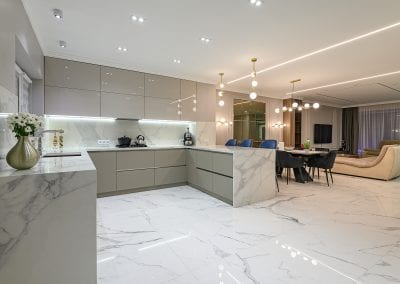 Marble Floors and Waterfall Countertops in Modern Kitchen