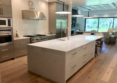 Modern White Kitchen with Marble Countertops