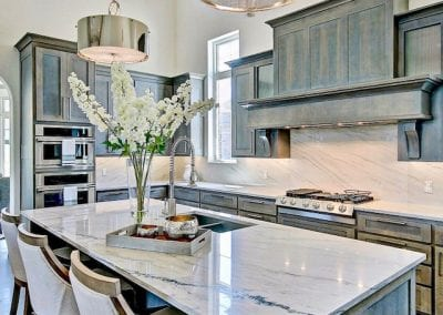 Rustic Luxury Kitchen with Marble Countertops and Backsplash